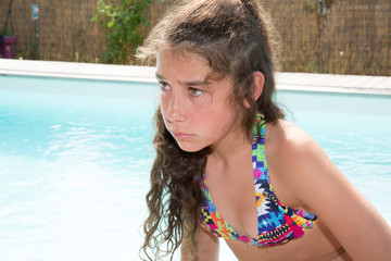 Beautiful brunette young woman in bikini in the outdoor
