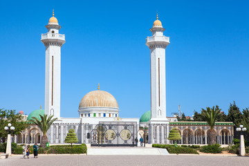 MONASTIR, TUNISIA, AFRICA - CIRCA NOV, 2012: Two minarets are in the .mausoleum of Habib Bourguiba in center of Monastir city. The first president in Tunisia was born in Monastir