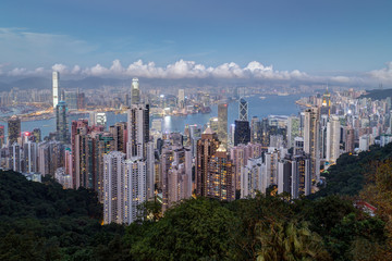 Scenic view of Hong Kong's famous skyline as seen from the Victoria Peak in the early evening. Copy space.