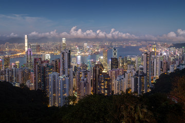 Scenic view of Hong Kong's famous skyline as seen from the Victoria Peak in the evening. Copy space.