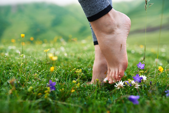 beautiful girls barefoot in cool morning dew on grass.