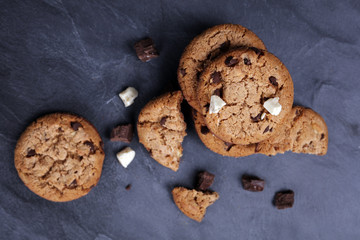 Double chocolate chip cookies on dark background