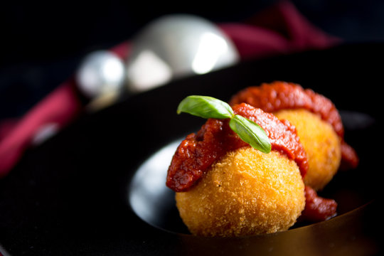Preview Save to a lightbox  Find Similar Images  Share  Edit Stock Photo: Arancini balls. Fried rice balls festive Christmas Italian rustic black plate dark red background. Snack, Sicilian street foo