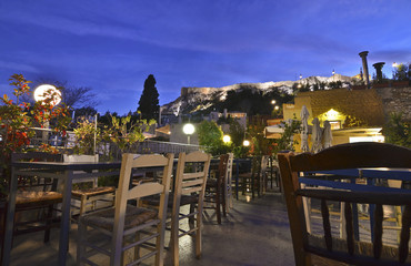traditional cafeteria on terrace Anafiotika Plaka Greece with Acropolis view