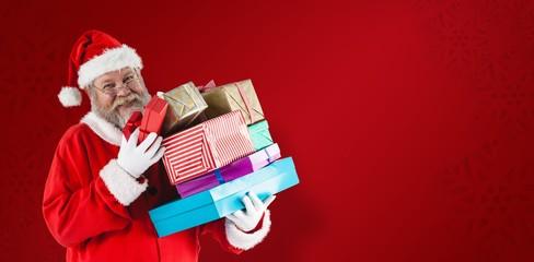 Composite image of portrait of cheerful santa claus