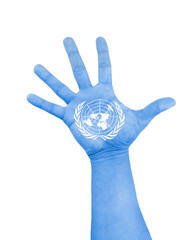 open hand raised with color blue and white of flag of UN United Nations flag painted