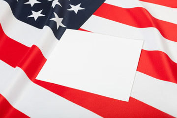 Close of USA ruffled flag with blank text board over it for YOUR TEXT OR IMAGE