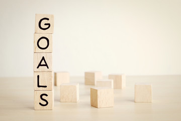 Goals word on wooden cube background