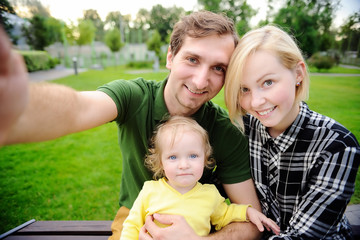 Happy family making selfie photo together