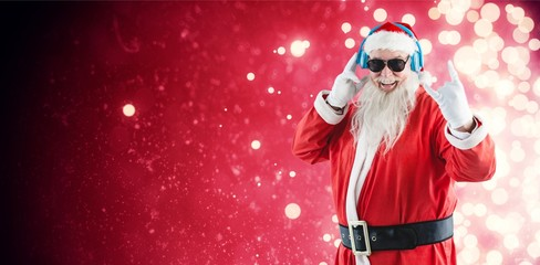 Composite image of cheerful santa claus showing hand sign while