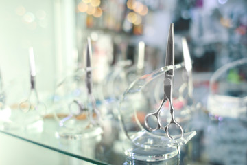 Professional barber scissors in cosmetic store