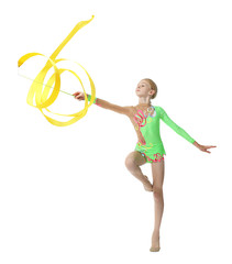 Young girl doing gymnastics with yellow ribbon, on white background