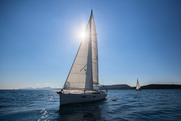 Sailing ship luxury yacht with white sails in the race on Sea.