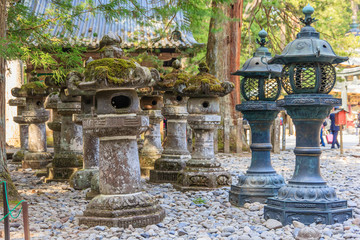 Stone pillar and metal lanterns in Toshogu shrine in Nikko, Japan