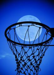 full moon in Basketball hoop at blue sky