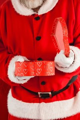 Composite image of midsection of santa claus opening gift box