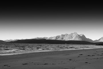Black and white Norway seashore mountain landscape background