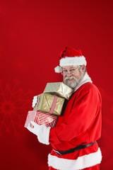 Composite image of portrait of santa claus holding  christmas gi