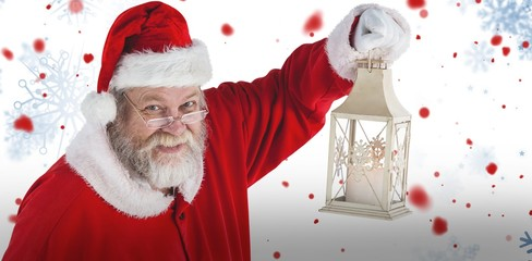 Composite image of portrait of santa claus holding christmas lan