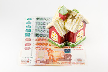 House and russian ruble money on white background