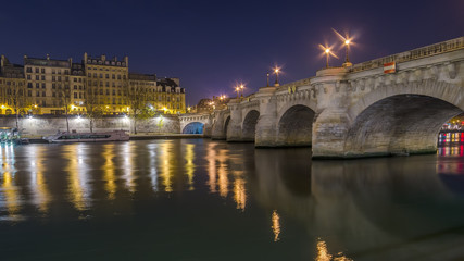 Paris, France: Seine river and the old town at night