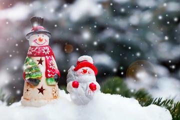 Snowman toys on a spruce