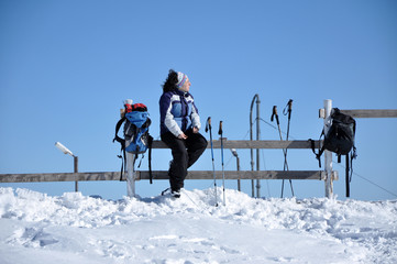Woman doing winter trekking in the mountains