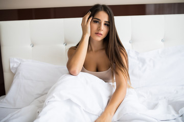 Young beautiful girl wake up in the morning at home