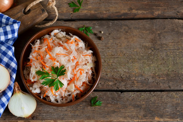 Marinated, sour cabbage with carrots and onions