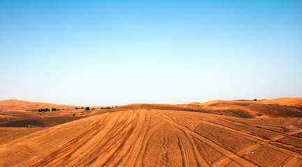 A high contrast and vibrant shot of a desert in Dubai (UAE) with blue sky