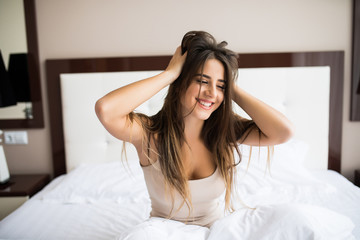 Woman smile and stretching in bed after wake up