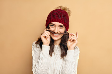Young beautiful woman winter portrait. Blue hat. Sunglasses. Hipster lifestyle. Happiness. Emotional face.