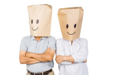 Couple with bags on head