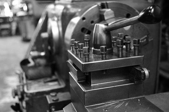 Obsolete lathe. Black-and-white photo.
