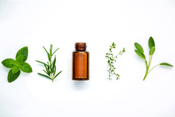 Wall Murals Condiments Bottle of essential oil with fresh herbal sage, rosemary, lemon