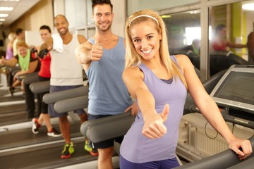 Happy people in gym