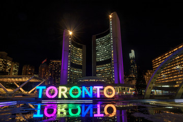 Wall Murals Toronto View of Nathan Phillips Square and Toronto Sign at night, in Toronto, Ontario.
