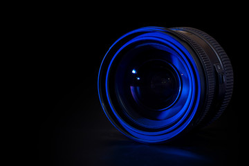 Front view of photo lens isolated on black background