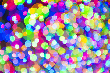Holiday Christmas tree lights background in bright and colorful bokeh abstract