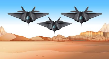 Three fighting jets flying over desert