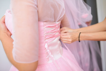 Girl Helping Bride with Dress