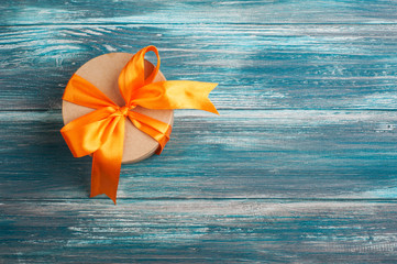 Orange bow with handmade present box