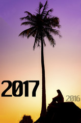 Silhouette young muslim woman on the stone and looking 2017 years