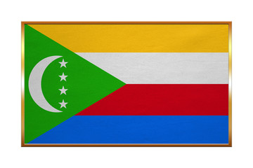 Flag of Comoros golden frame, fabric texture