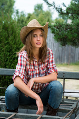 Young cowgirl in hat