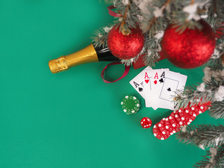Playing cards and poker chips near a Christmas tree