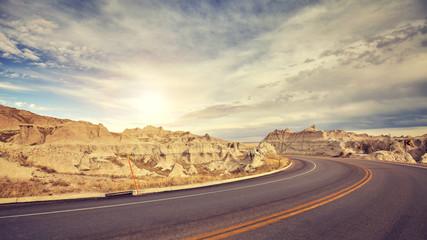Vintage toned desert road just before sunset, travel concept.