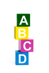 wooden toy cubes with letters. Abcd