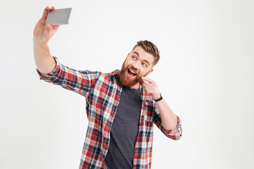 Happy young man taking selfie photo