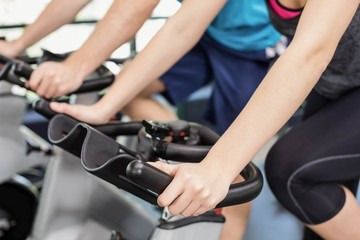 Fit group of people using exercise bike together